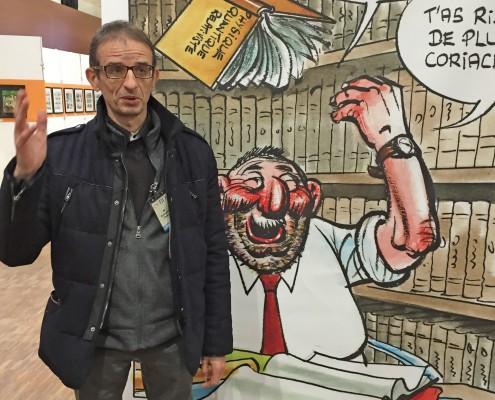 Daniel Goossens devant son dessin sur le SoBD 2015